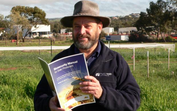 DAFWA development officer Jeff Russell with the biosecurity manual