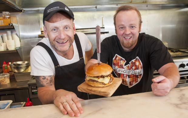 Justin Bell (left) of Jus Burgers pictured with Best Burger in the West winner Gus Gallagher (right).