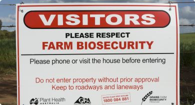 A sign on the farm gate asking visitors to respect farm biosecurity
