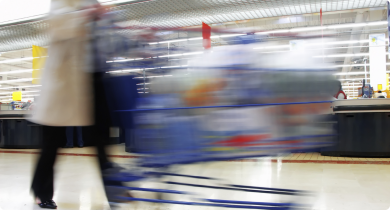 shopping trolley being pushed by consumer