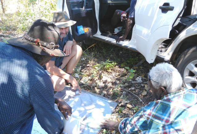 Photograph of male Garralyel (knowledgeable senior community members) helping DAFWA staff to plan the fieldwork program