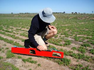 photograph of a person using the EM38 to estimate salinity level in a paddock