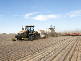 Dry seeding machinery in a paddock