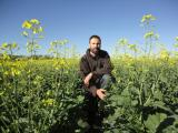 Martin Harries in a paddock of canola sown in wide rows
