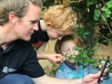 DPIRD staff and sons looking at plants and using MyPestGuide Reporter app on mobile phone