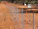 A new trial fence with orange fence posts to make the fence more visible to animals