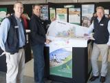 Two Geographic Information Services staff hold a map of Merredin Shire at the DAFWA display at the Dowerin Field Day.