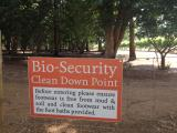 on-farm biosecurity signage at an orchard entrance