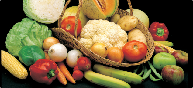 Display of different fruit and vegetables in a basket, including rockmelon, carrots, capsicum, cauliflower, tomato,apples, onions, bananas, beans, potatoes, lettuce and sweet corn