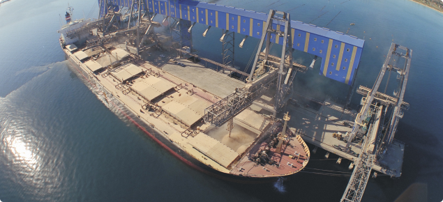 Ship being loaded at port
