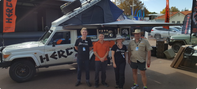 DPIRD Ag and Fisheries staff with Caravan exhibitor standing together