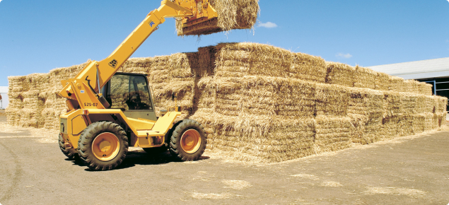 Image of a telly lifter stacking large export square hay bale
