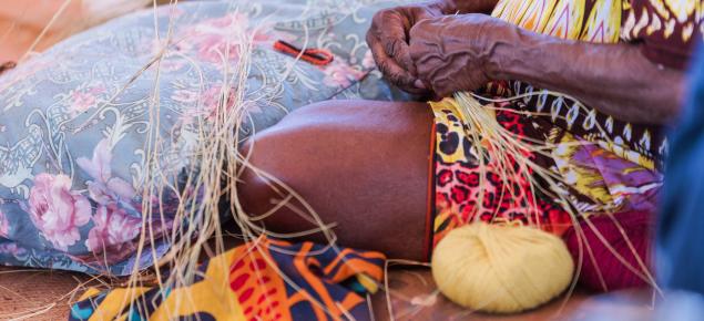 An Aboriginal women doing crafts