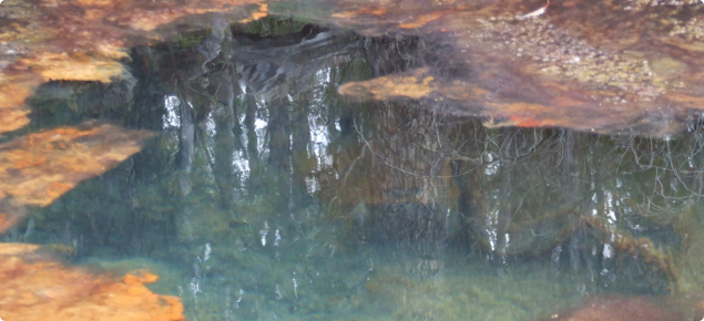 Picture showing clear blue green coloured water caused by dissolved aluminium