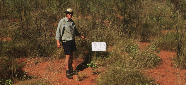 Photograph of a DAFWA rangeland officer on a state monitoring site