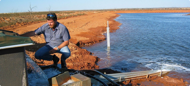 Constructed evaporation basin being filled with saline water