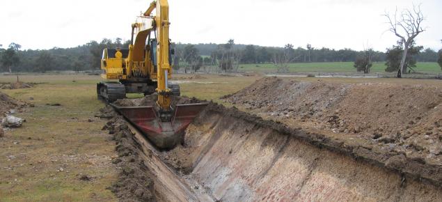 Digging a deep drain near Darkan. The drain is V-shaped.