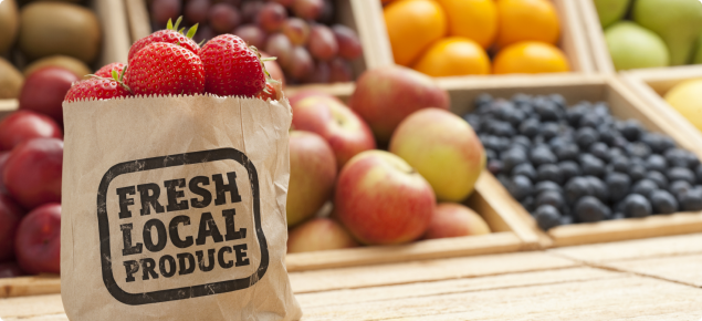 Fresh local produce label on a bag of fresh strawberries