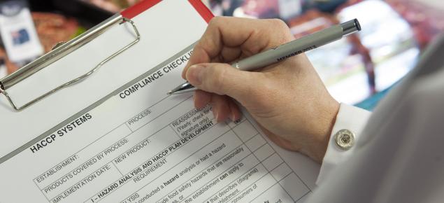 Person completing HACCP checklist