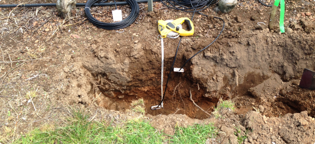 Soil moisture monitoring probes being installed in an apple crop in Manjimup.