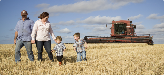 Farming family in field