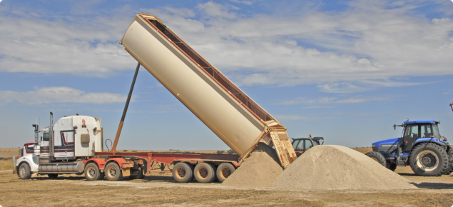 Truck delivering limesand to a paddock