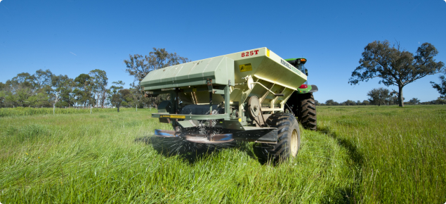 Spreading fertiliser on pastures in spring