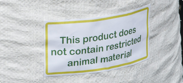 Bag of sheep pellets with a label indicating the feed does not contain restricted animal material.