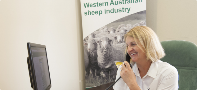 image of DAFWA Sheep NLIS helpdesk officer, Jac Pearson helping a client on the telephone.