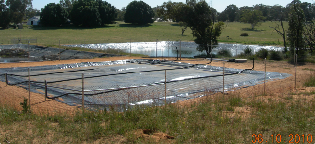 GHG emissions from piggery manure is managed by use of a covered effluent pond, which is fenced, for safety