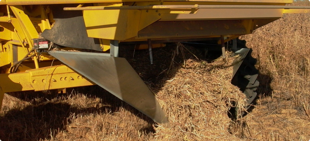Modifications to the header to generate a narrow chaff trail concentrating weed seeds and allowing a hot burn