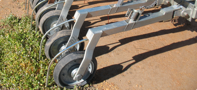 Seeder press wheels with setup for banding wetting agents