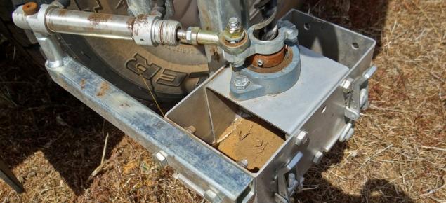 Close photograph of a mechanical Terrier soil sampler