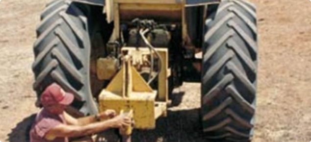 Tractor-mounted ripper for rabbit warren destruction.