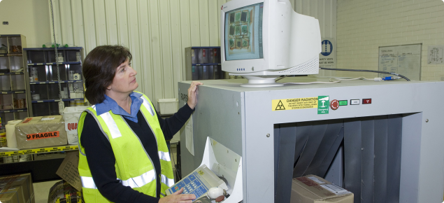 Quarantine inspectors use x-ray to inspect mail parcels entering WA
