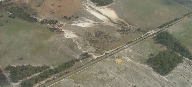 Aerial image of paddock rill, sheet and gully erosion after a heavy rainfall event, April 2005