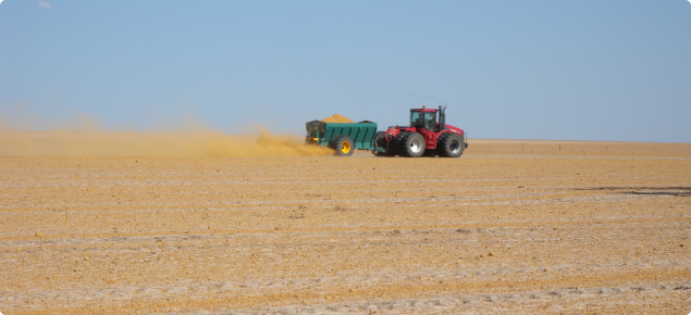 Photograph of clay spreader in action across a paddock susceptible to wind erosion