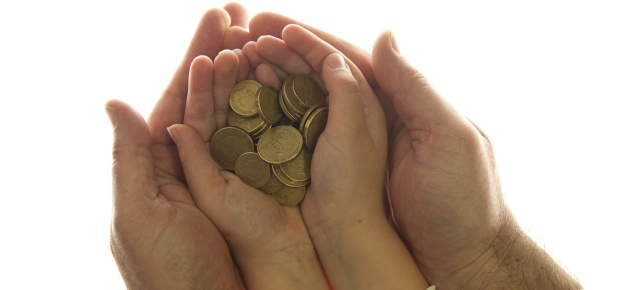 two hands holding coins