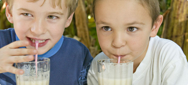 children drinking banana smoothies