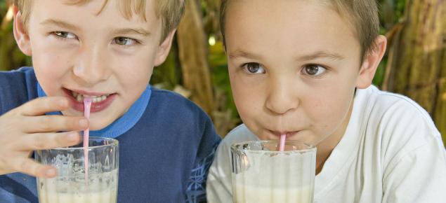 children drinking banana smoothies