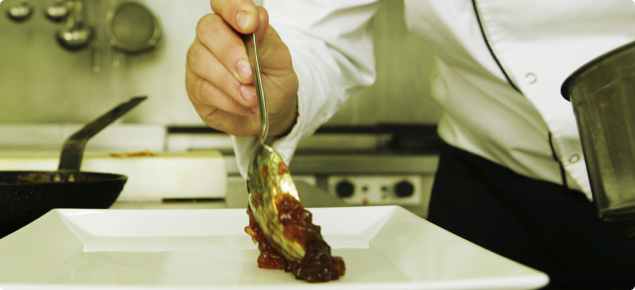 Chef plating up a meal.