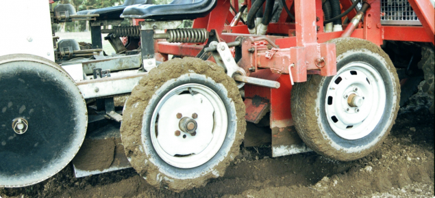 Two 15cm wide rotary hoes contained within metal housings under a vegatable planter