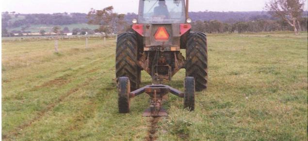 tractor pulling mole plough to dig a mole drain
