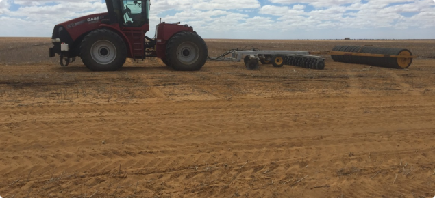 Tractor towing a set of offset discs and tyre roller