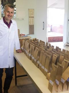 Researcher with seed packets