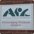Logo of Agricultural Produce Commission shows its stylised initials plus the slogan 'Encouraging Producer Initiative'