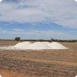 Agricultural lime dumped in a paddock ready to be spread.