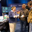 eConnected's Alison Lacey (Manager, Narrogin) speaks with farmers Rob Rex (Wagin) and Warren Pensini (Boyup Brook) about eConnected's LoRaWAN on-farm connectivity network with a demo board and devices.
