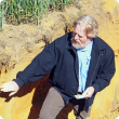 Photo caption: DAFWA senior researcher Chris Gazey points out an acidic sub-surface to growers at a field day in Mingenew.