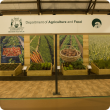 The entrance to DAFWA's display with large crop images in the background.